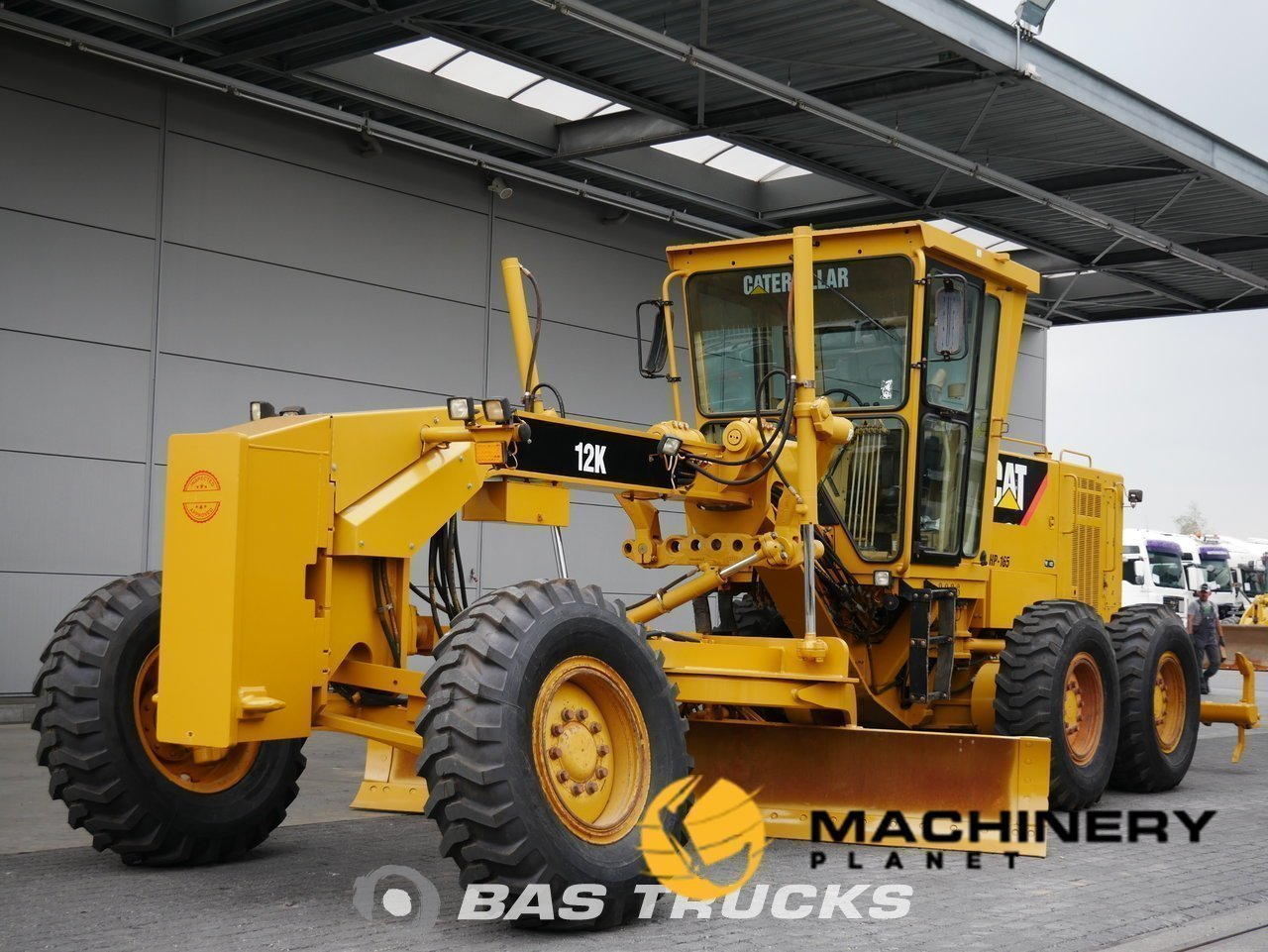 Used-Construction-equipment-Caterpillar-12K-6X4-2011_138120_1-1554199562323_5ca3340a4ec14-1.jpg